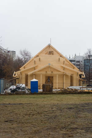 Moscow, Russia, December 27, 2019: Construction of a wooden Temple in honor of the Holy Royal Martyrs.