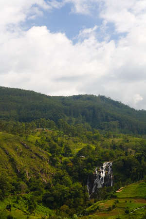 Beautiful mountain landscape of Ella with a waterfall in the distance. The nature of Sri Lanka.