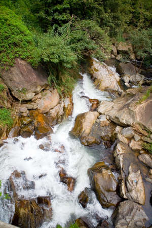 Beautiful stream of a mountain river among the stones. The nature of Sri Lanka.