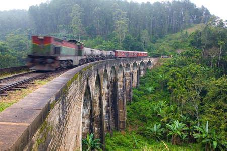 The old train goes over the nine-arch bridge. Motion blur. 版權商用圖片
