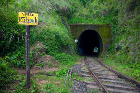 Speed limit sign in front of a railway tunnel. Sri Lanka.