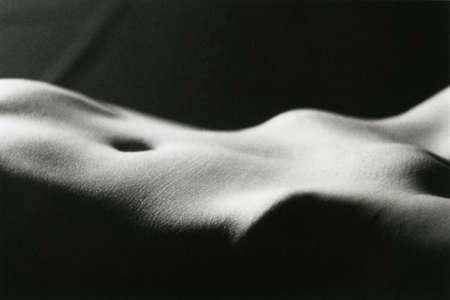 Midsection and pubis of a young slender girl. Attention! Image contains grit and other artifacts of analog photography!