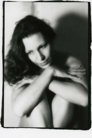 Soft portrait of a young woman in the style of pictorialism. Attention! Image contains grit and other artifacts of analog photography!