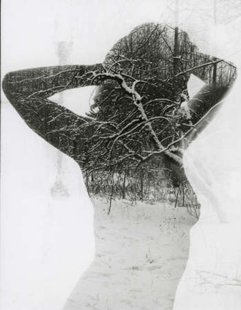 Naked slender girl and winter nature in one frame. Attention! Image contains grit and other artifacts of analog photography!