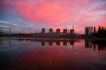New homes are reflected in the river at dawn. Construction in Moscow. Reklamní fotografie