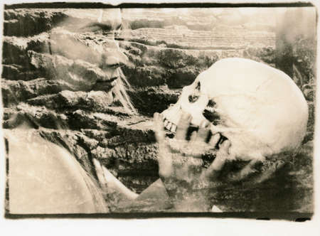 The girl holds a human skull in her hands. Multiple exposure. Abstraction. Attention! The image contains grain and other analog photography artifacts!