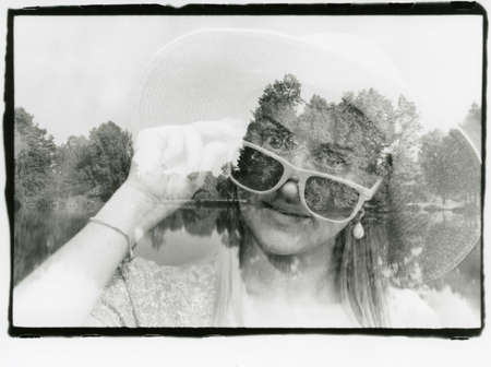 Girl in a hat and glasses from the sun and nature. Attention! The image contains grain and other artifacts from analog photography!