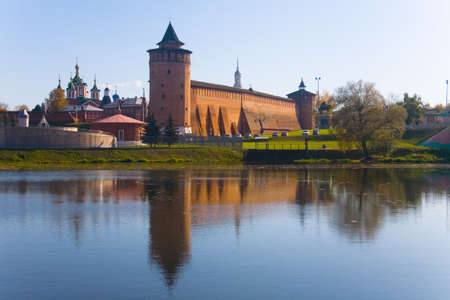Marina tower of the Kolomna Kremlin is reflected in the water. Autumn day.