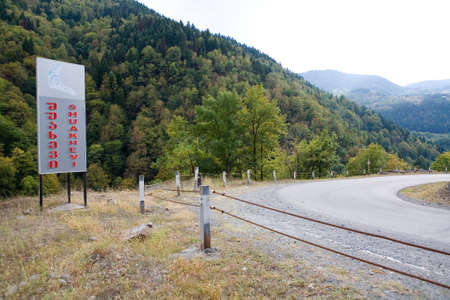 A road sign with the name of the Chuakhevi settlement. Georgia.