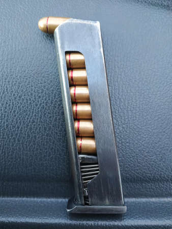 Eight cartridges of a Makarov pistol in a clip are photographed in close-up. Ammunition. Reklamní fotografie