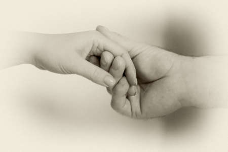 Female and male hands are photographed close-up. Relations.