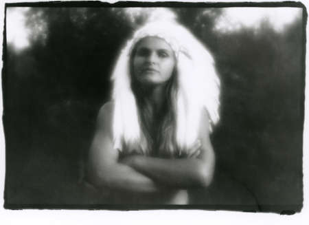 Portrait of a beautiful girl in an Indian headdress. Attention! Image contains graininess and other analog photography artifacts! Reklamní fotografie