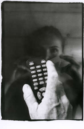 The male hand presses the mute button, the girl seals her mouth. Multiple exposure. Attention! Image contains grain and other artifacts from analog photography.