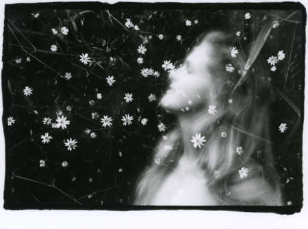 Portrait of a beautiful girl and flowers close-up. Multiple exposure. Attention! Image contains grain and other artifacts from analog photography. Reklamní fotografie