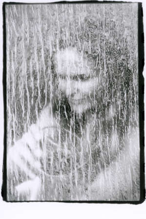 Abstract portrait of a young woman in black and white. Multiple exposure. Attention! The image contains grain and other artifacts from analog photography. Reklamní fotografie