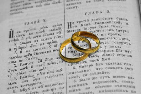 Gold wedding rings on sheets of the old Russian Bible