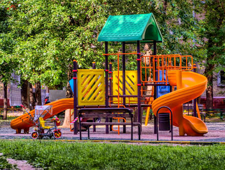 Children playground in the yard in summer photo