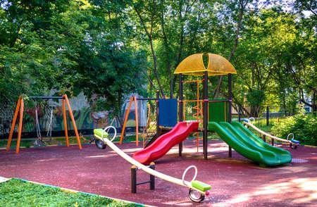 Children playground in the yard in summer 스톡 콘텐츠
