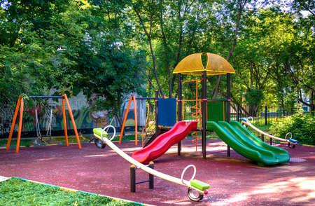 Children playground in the yard in summer Stok Fotoğraf
