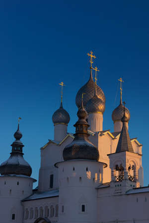 Orthodox church in the winter against the bright blue sky