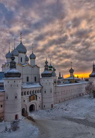 The Rostov Kremlin in the winter against the setting sun