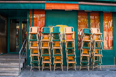 Chairs at cafe are put waiting for opening Stok Fotoğraf