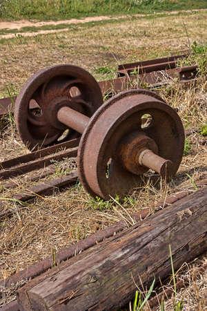 old rusty railway wheels on a grass