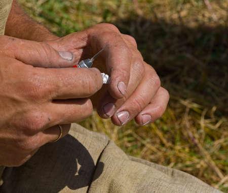telltale: The handicraftsmans hands a knife cut out a figure from tin