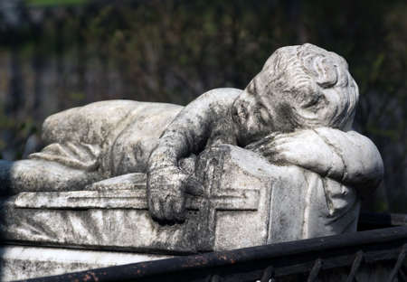 ancient Gravestone monument in the form of child