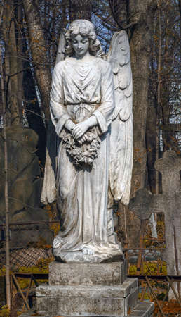 ancient Gravestone monument in the form of an angel