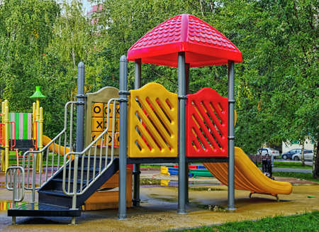 entertaining area: empty Playground in park after a rain