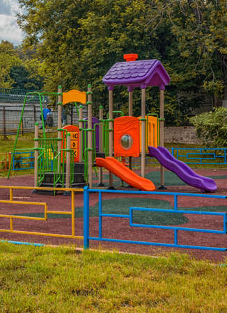 entertaining area: empty Playground in park in he fail Stock Photo