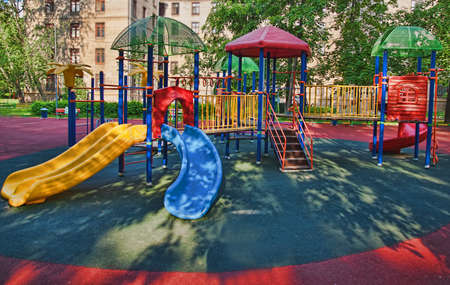 entertaining area: empty Playground in the yard in summer Stock Photo