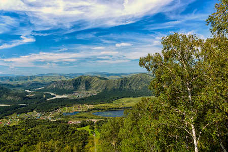 mountain landscape with the lake and the village in summer day Stok Fotoğraf