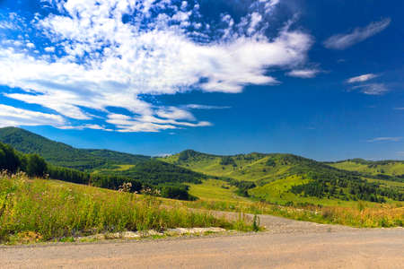 mountain road in the bright summer afternoon