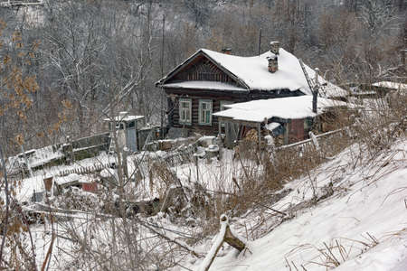 the traditional wooden rural house in Russia in the winte