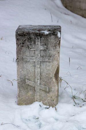 marble slab on a monastic cemetery in the winter