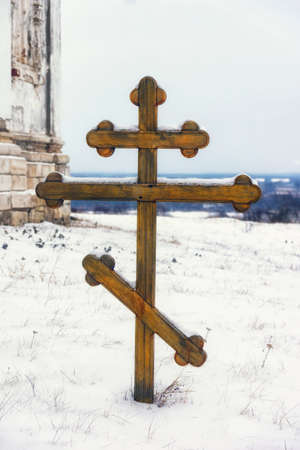 wooden cross on a monastic cemetery in the winter Stok Fotoğraf