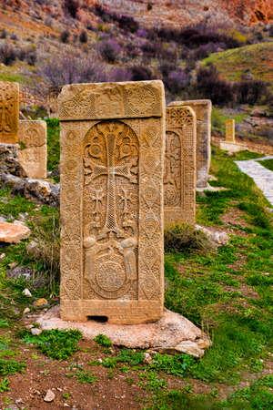 armenian Cross carved on orange stone Stok Fotoğraf