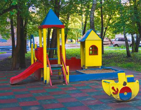 children playground in the yard in summer Stok Fotoğraf - 65417564