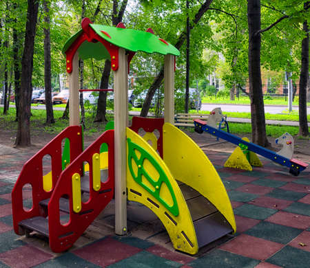 children playground in the yard in summer Stok Fotoğraf - 65417569