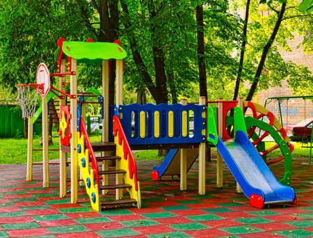 children playground in the yard in summer Stok Fotoğraf