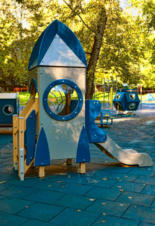 children playground in the yard in summer Stok Fotoğraf - 65417442