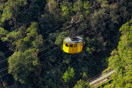 Yellow cabin of the funicular at the monastery Montserrat in Spain Stok Fotoğraf - 75901077