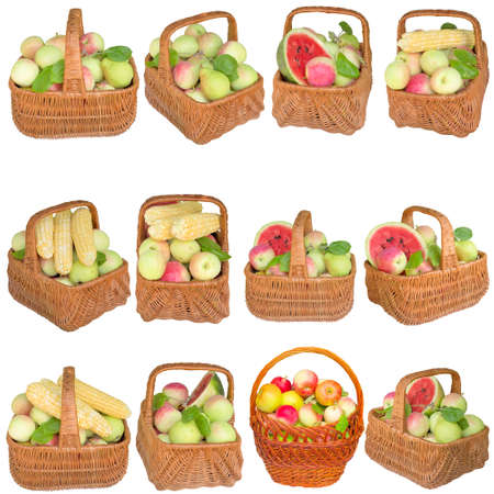 Apples in a wooden basket isolated on white background. Stock Photo