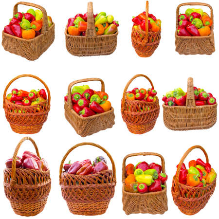 Basket with red paprika isolated on a white background.