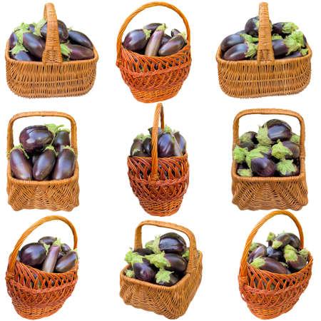 Basket with fresh eggplants on a white background. Stock Photo