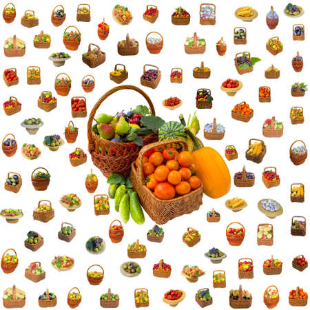 Baskets with fruit and vegetables isolated on a white background.