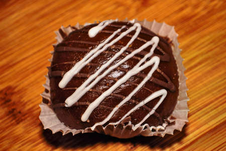 Round chocolate cookies with white stripes
