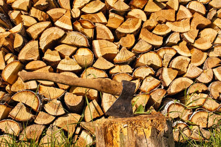 The ax on the background of woodpile